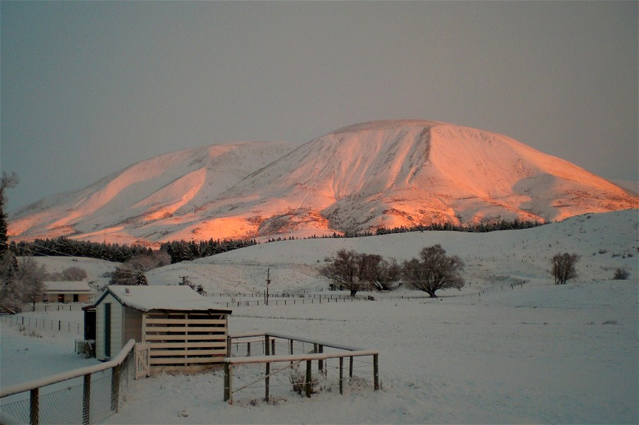 Sunrise in winter with my wood shed in the foreground.