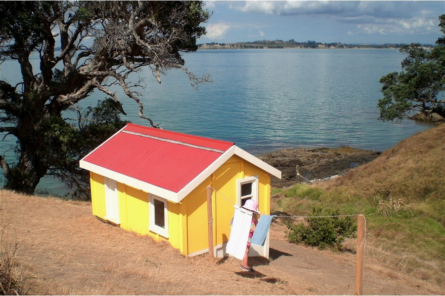 "Matthew Muir's work, ""April, 1975"" depicting the summer holidays spent in tiny holiday houses called a ""bach"" in New Zealand."
